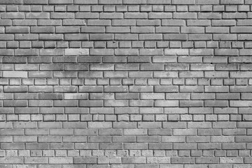 brick textured background or wallpaper of monochrome gray color