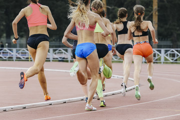 race of women athletes in stadium during athletics competitions