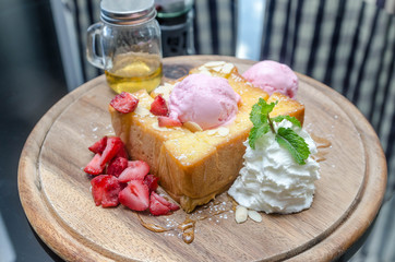 closeup of honey toast with ice-cream and fruits