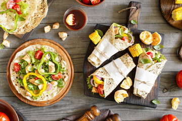 Tortilla with grilled chicken fillet and grilled vegetables