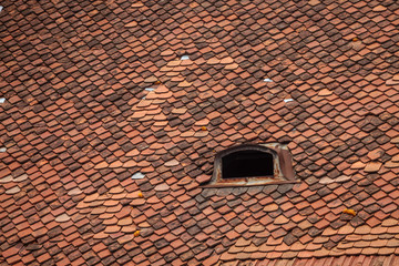 Color picture of red tile roof with skylight