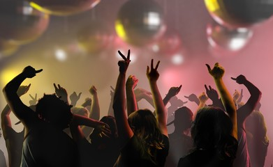 Nightlife and disco concept. Silhouettes of young people are dancing in club.