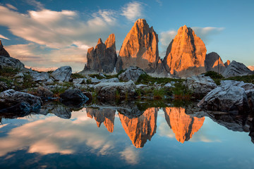 Tre Cime di Lavaredo with reflection in lake at sundown, Dolomit