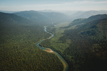 Top view of the taiga forest and river. The vast expanses of Eas