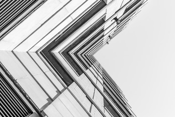 Urban Geometry, looking up to building. Modern architecture black and white, concrete and glass.  Abstract architectural design. Inspirational. Artistic image and point of view.
