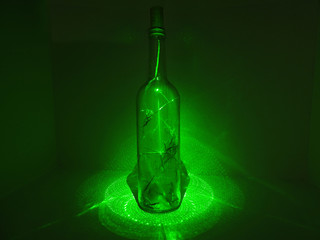 Glass bottle in laser abstraction