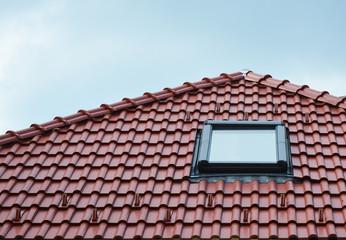Attic skylight window on red ceramic tiles house roof outdoor. Attic Skylights Home Design Ideas Exterior.