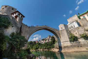 """The Old Bridge with river Neretva. """"Stari Most"""" was built in 1557 by Ottomans. Old Bridge is inscribed on World Heritage List by UNESCO in 2005."""
