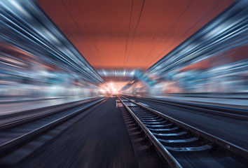 Railway station at night with motion blur effect. Railroad