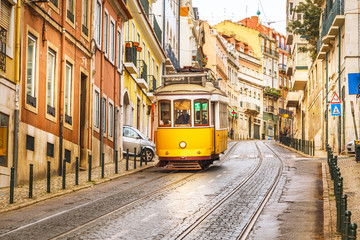 Classic yellow tram on a street in Lisbon, Portugal