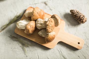 fresh white mushrooms on wooden board