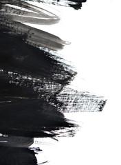 black brush strokes on white paper