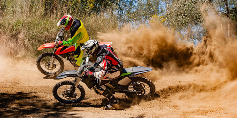 Motocross riders race around a corner