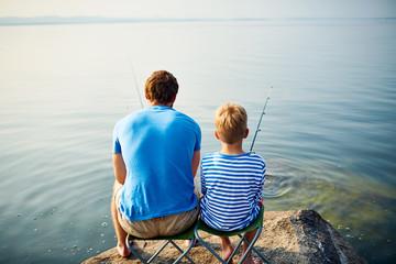 Backs of fishermen