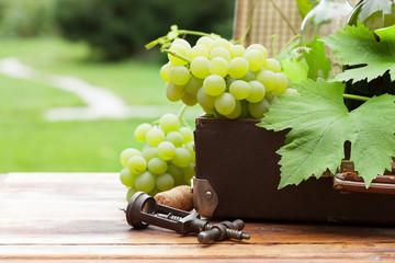 White grape and wine bottles