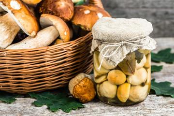Marinated mushrooms - boletus pickled in jar on rustic table, pr