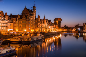 Gdansk old town with harbor and medieval crane in the night
