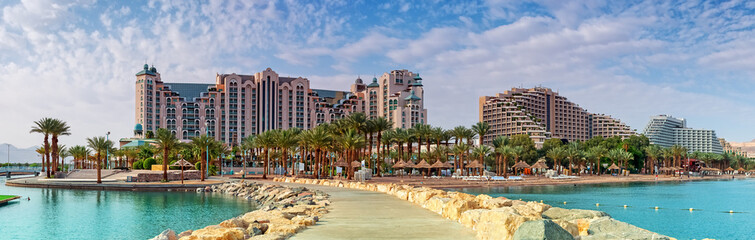 Central public beach of Eilat at sunset. Eilat is a famous resort city in Israel
