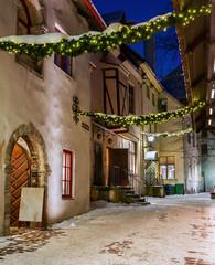 Night, holiday lane (Katarina) of the old Tallinn. Colorful, old houses. Empty street. Estonia. Winter.