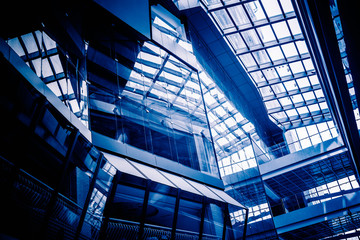 Low Angle View Of Glass Roof of modern building in blue tone.