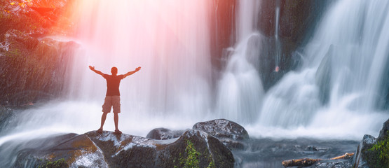 Man on a Great waterfall