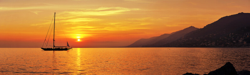 Panoramic view of Sailing at sunset with mountains