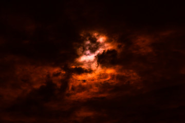 Wildfire sky with smoky black and red clouds, nature abstract ba