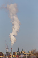 Dark reddish smoke and air pollution spewed from coal-powered plant stacks