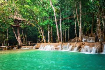 Jangle landscape with amazing turquoise water of Kuang Si cascade waterfall at deep tropical rain forest. Luang Prabang, Laos travel landscape and destinations