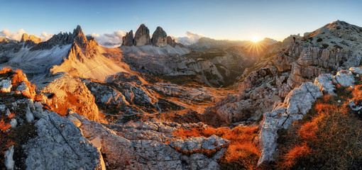 Dolomites mountain panorama in Italy at sunset - Tre Cime di Lav