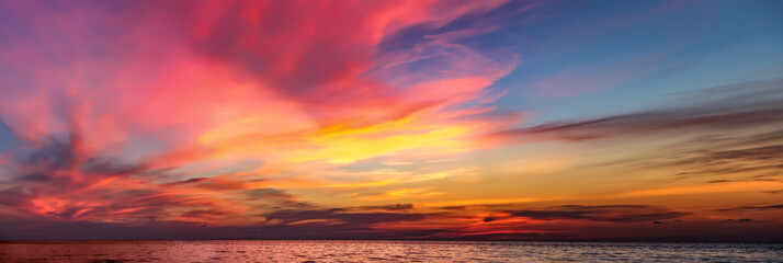 Tropical colorful dramatic sunset with cloudy sky . Evening calm on the Gulf of Thailand. Bright afterglow.