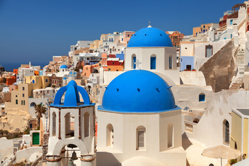 Landscape of Oia town in Santorini, Greece with blue dome church