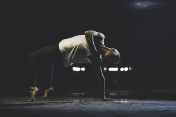 Attractive teenager standing on dance pose.