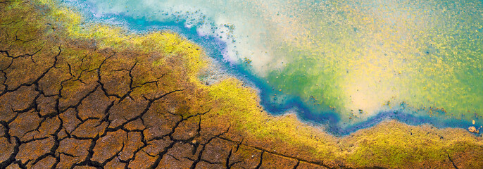 Polluted water and cracked soil during summer drought