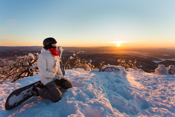 snowboarder on the mountain in the evening at sunset