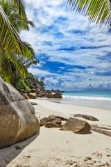 Rocks on tropical sandy beach Seychelles