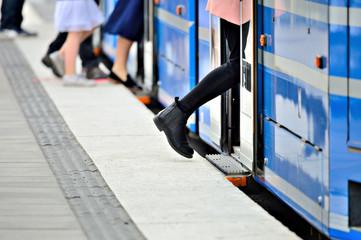 Woman entering tram