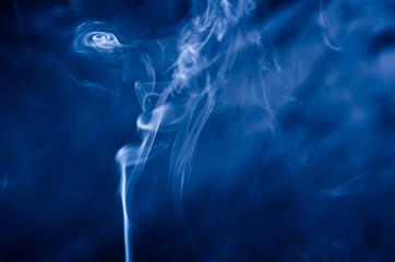 blue smoke on a dark background