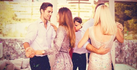 Composite image of young friends dancing at home