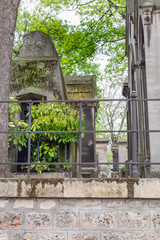 Piece of old french cemetery in Paris. Spring, summer day. Selective focus.