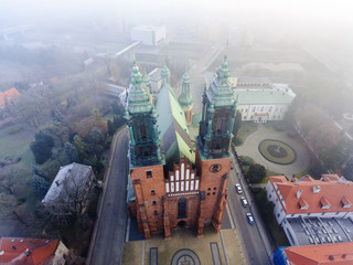 The Archcathedral Basilica of St. Peter and St. Paull in polish city Poznan Ostrow Tumski square.Aerial view, foggy day
