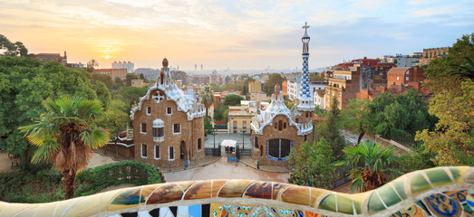 Park Guell in Barcelona. View to entrace houses with greenery on foreground