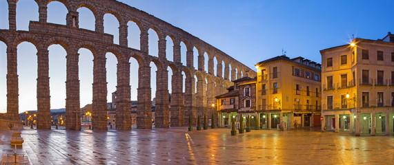 SEGOVIA, SPAIN, APRIL - 13, 2016: Aqueduct of Segovia and Plaza del Azoguejo at dusk.