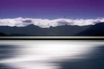 Norway ocean and mountains on horizon abstraction background