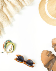 Summer outfit. Summer background. Lace dress, straw hat, sandals, brown sunglasses, bracelet. Flat lay, top view, round view.s