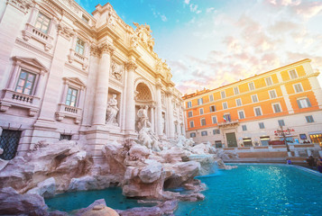 restored Fountain di Trevi in Rome in sunrise light with sunshine, Italy