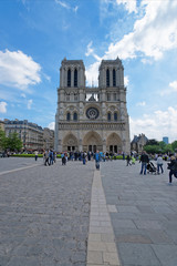 People at Notre Dame de Paris Cathedral in Paris France