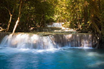 Deep blue stream waterfall in the jungle,natural landscape background