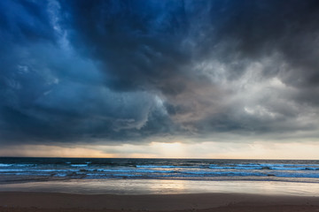 Gathering storm on beach