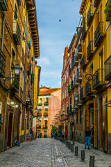 view of a narrow street in the center of madrid